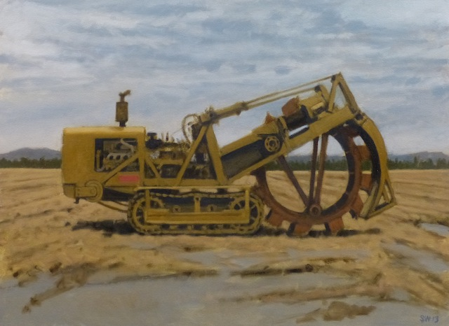 trench digger in a field - 2013