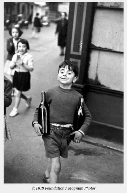 Henri Cartier-Bresson - kid with bottles